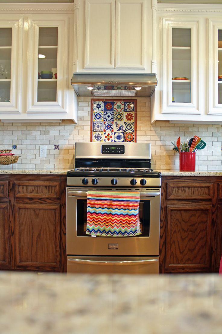 Spanish kitchen design with talavera tile and travertine
