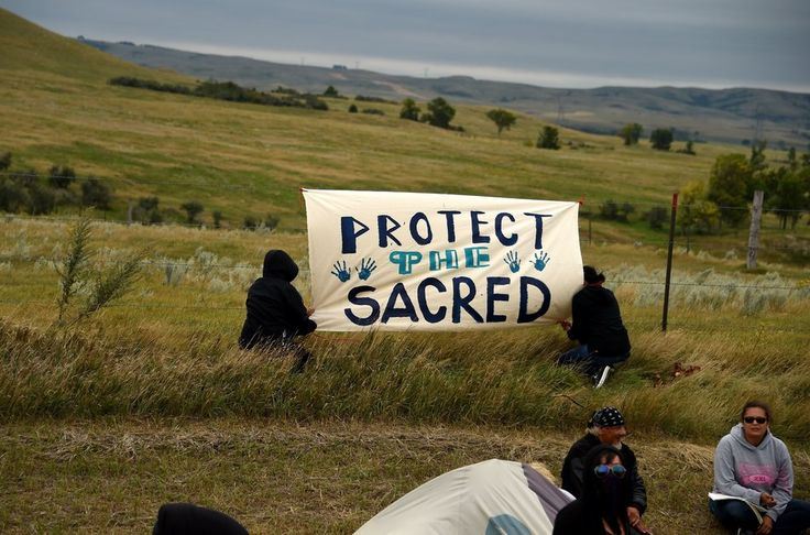 Here's What You Should Know About The Dakota Pipeline Protest | Huffington Post - People hang a sign near a burial ground sacred site that was disturbed by bulldozers building the Dakota Access Pipeline (DAPL).
