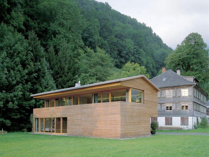 maison boisée et vitrée