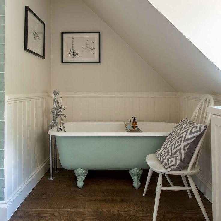 small bathroom with roll top bath and sloping ceiling - Bath Bathroom