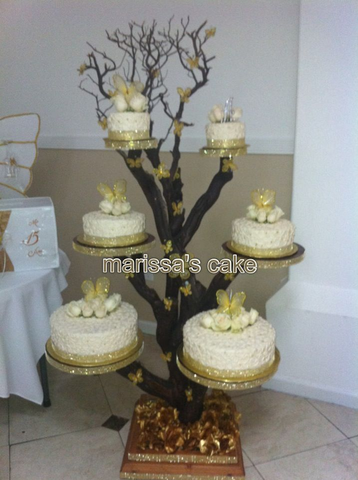 Butterflies Quinceanera cake on tree stand. Visit us http:/Facebook.com/Marissa'scake or www.elmanjarperuano.com
