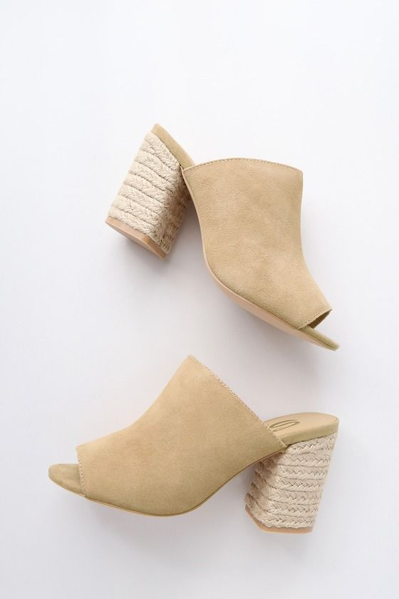 Take your feet on vacay in the Sbicca Helena Natural Suede Leather Espadrille Mules! A genuine suede, peep-toe upper shapes these vacay-ready mules with a trendy espadrille wrapped block heel. Available in whole sizes only.