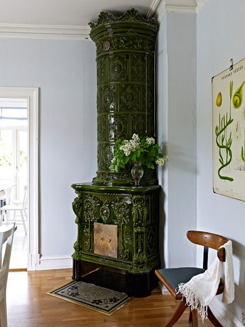 Green tile antique fireplace in Smögen, Sweden