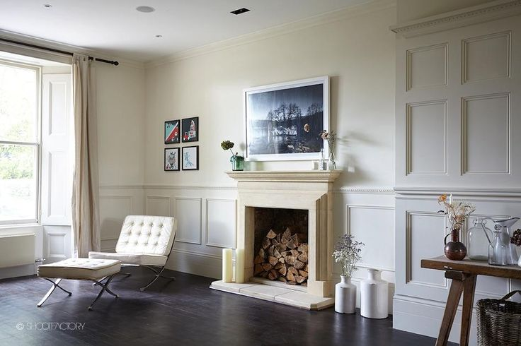 minimalist white fireplace with architectural moulding in a traditional space in Beckenham, London