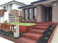 Melbourne Landscaping, decorative retaining wall, deck, plants, mulch, turf