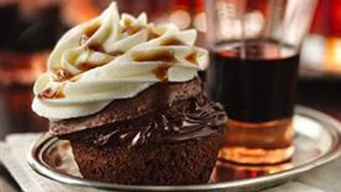 "A bit of bourbon, a hit of coffee liqueur and some vanilla vodka-spiked frosting make these sophisticated chocolate cupcakes the ultimate ""holiday helper."" 24 cupcakes"