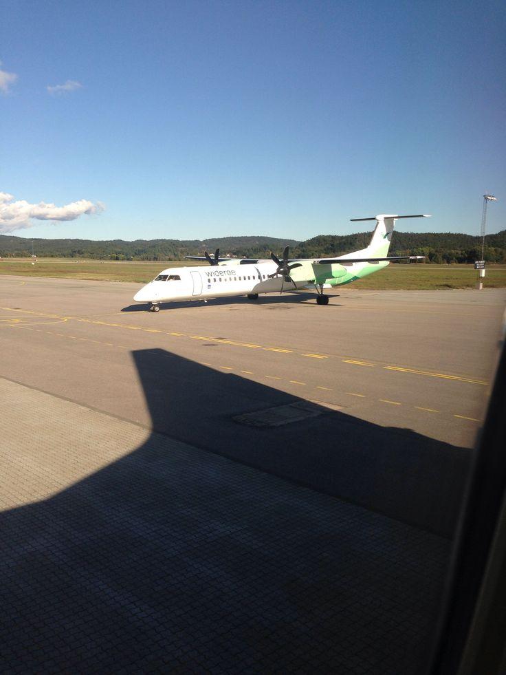 A Widerøe Dash-8 at Kristiansand airport, Kjevik in spring 2014