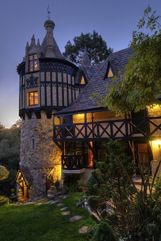 Not a cabin by any means, but I like Tudor houses and castle-ish things.  Something small, along these lines, nestled into a woods someplace would be lovely.