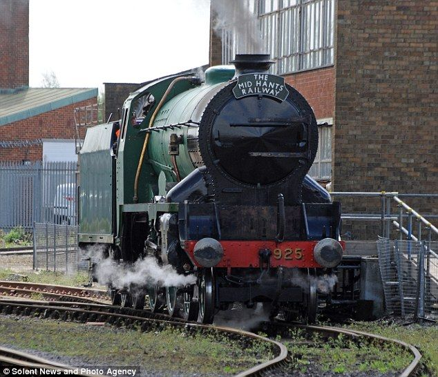 There she blows: The No. 925 Cheltenham is taken for a test run at Eastleigh Rail Works near Southampton after being restored