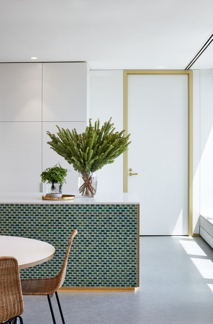green mini subway tiles with gold and wood accents.