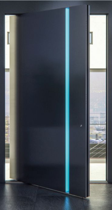 Our newest design of a sleek pivot door. The impressive detail of the hidden light in the handle garantees a futuristic and elegant look wherever it is installed.