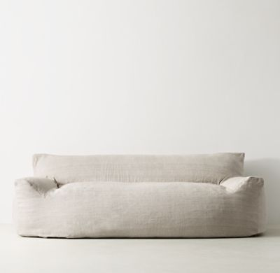 RH TEEN's Berlin Lounge Linen Sofa:The next-generation bean bag. Our collection's body-conforming foam-and-bead insert ensures classic sink-in comfort, while the raised back and arm rests add an element of support to its relaxed silhouette.