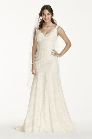Simple yet elegant, this lace trumpet gown is truly one-of-a-kind!  Allover ivory lace gown with scalloped v-neckline.  Tank straps provides light coverage while accentuating shoulders.  All over beaded lace applique add drama to bodice and skirt.  Chapel train. Sizes 0P-14P.  Available in Ivory and White by special order only in store and online.  Fully lined. Imported polyester. Dry clean only.  Missy: Style WG3757. Sizes 0-14.  Available in store and special order only online.  Woman…