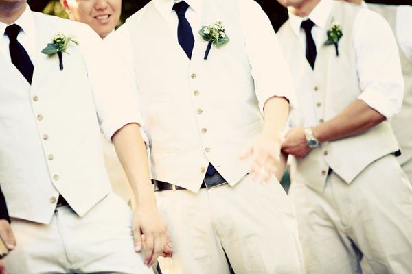 light grey vests and midnight blue ties: groomsmen attire