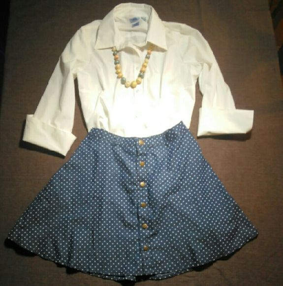 """HP!!! 4/11"" American Rag Skirt This really adorable skirt by American Rag, has a blue jean look with white polka dots and copper colored buttons. It is a size small and made of 100% cotton. It does have a partial tag still on it and has never been worn. It measures 17 inches from the front. Necklace also for sale in separate listing. The skirt has a 13 and a half inch measurement across the top, so 27"" waist with elastic in the back. It also features belt loops and pockets. American Rag…"