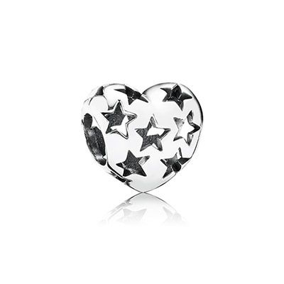 PANDORA's much-loved sterling silver heart charm has gained a beautiful, hand-finished openwork design: a constellation of cut-out stars. Signifying love, guidance and aspiration, this charm is a must-have piece for any collection. #PANDORAcharm