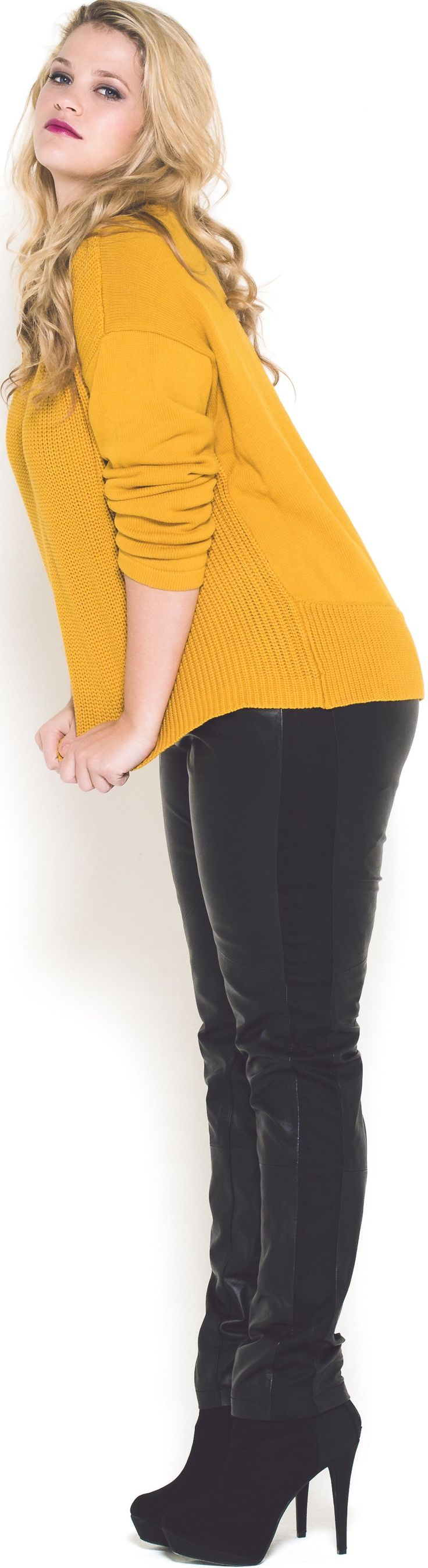 Cute yellow plus-size designer sweater for fall & winter. Read article about designer brands and boutique websites with international shipping. This is not the old article: http://www.boomerinas.com/2014/10/29/trendy-plus-size-clothing-stores-online-29-boutiques-designers-worldwide-with-us-delivery/