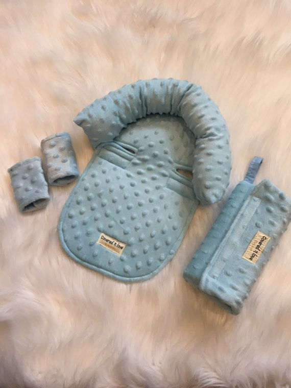 Handmade and stylish !! So soft and cozy !! Perfect for newborns and infants while in an infant car seat. Covered N Love CUDDLE package includes 1 headrest , 1 set of strap covers , 1 arm bar pad - Two velcro straps for easy attachment to any infant car seat. - Sof minky fabric for