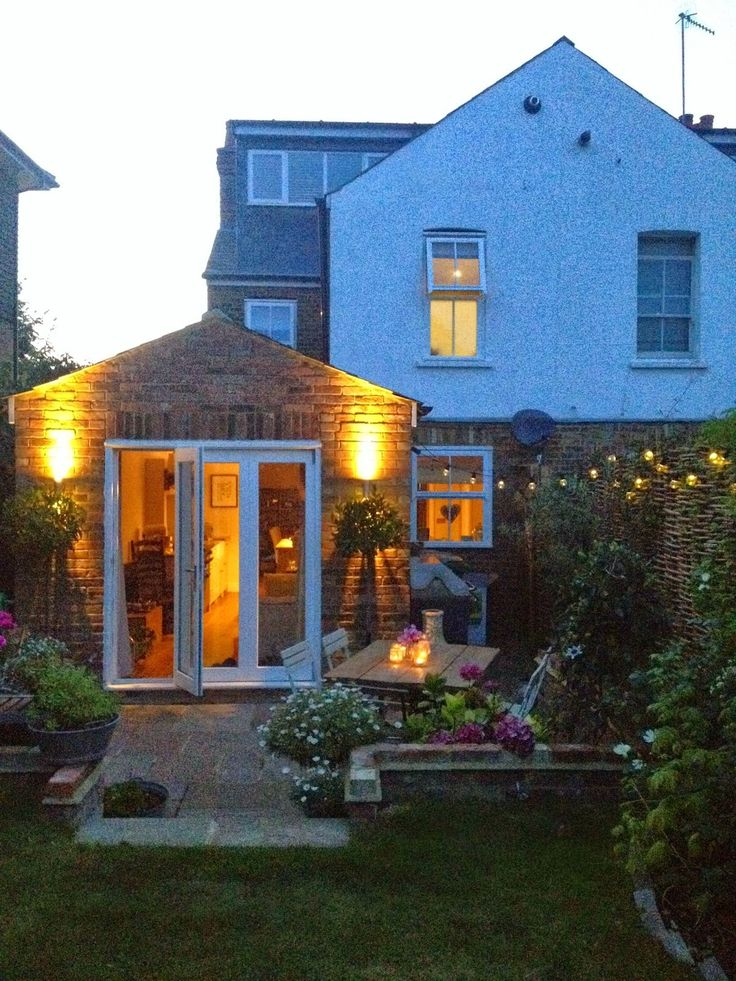 English Cottage Garden Victorian terrace garden courtyard bistro lights