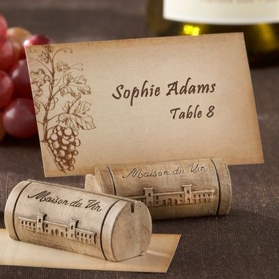The perfect favor for when two wine-lovers wed: a resin cork place card holder that doubles as a photo holder and comes with a vine-and-grape motif place card.