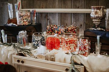 Candy bar on a vintage white table. Photo from Ashley & Jacob collection by Jenna Borst Photography