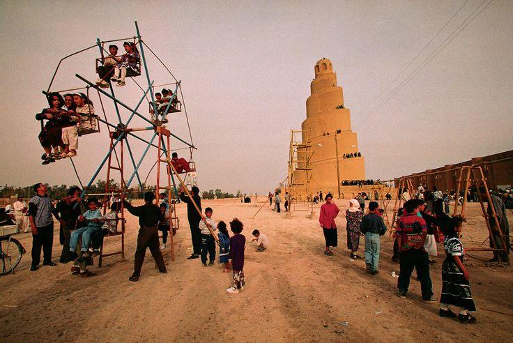 Children's games beneath the magnificent spiral minaret in Samarra, 1100 years old. © Michael Yamashita