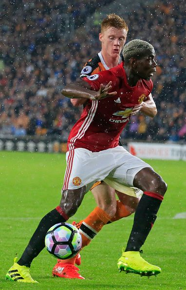 Manchester United's French midfielder Paul Pogba vies with Hull City's English…