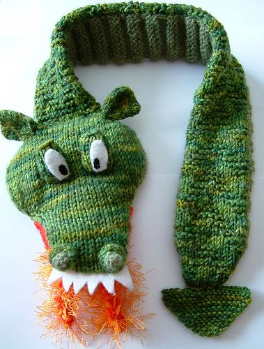 Free Pattern Fiery Dragon Scarf by Brooke L. Hanna = add a large hair clip in head to clamp on tail when wearing