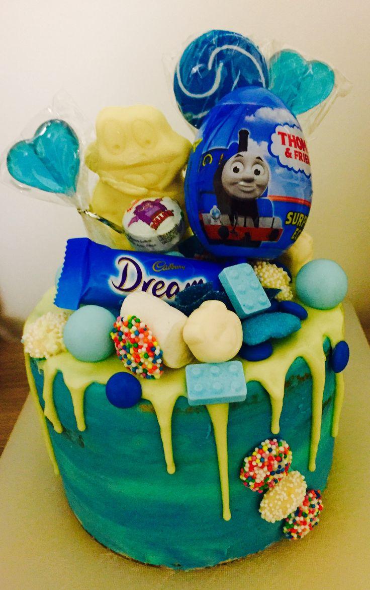 Vanilla blue drip cake. Thomas the Tank, lolly cake