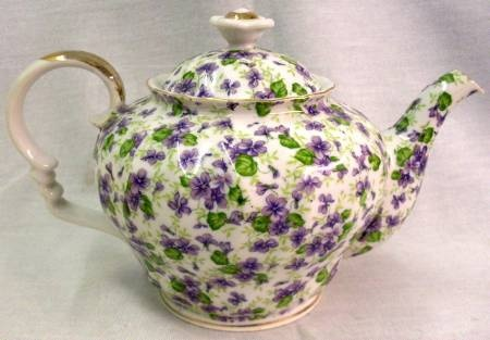 Lefton China Gold Trimmed Violets Teapot. A lovely pattern of violets decorate this traditional style teapot with hand painted gold highlights.