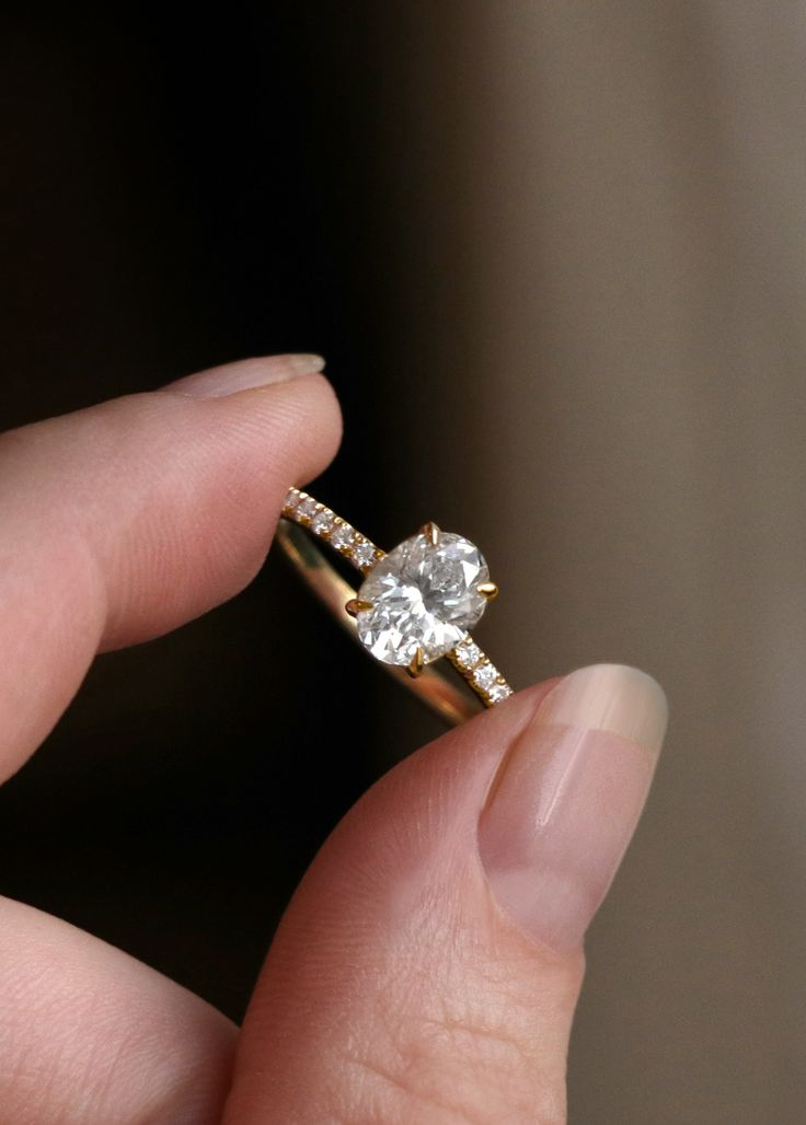 VOW: Vrai & Oro Wedding - Modern Engagement Rings. 18k Oval Engagement Ring with Pavé Band and simple 4-prong setting.