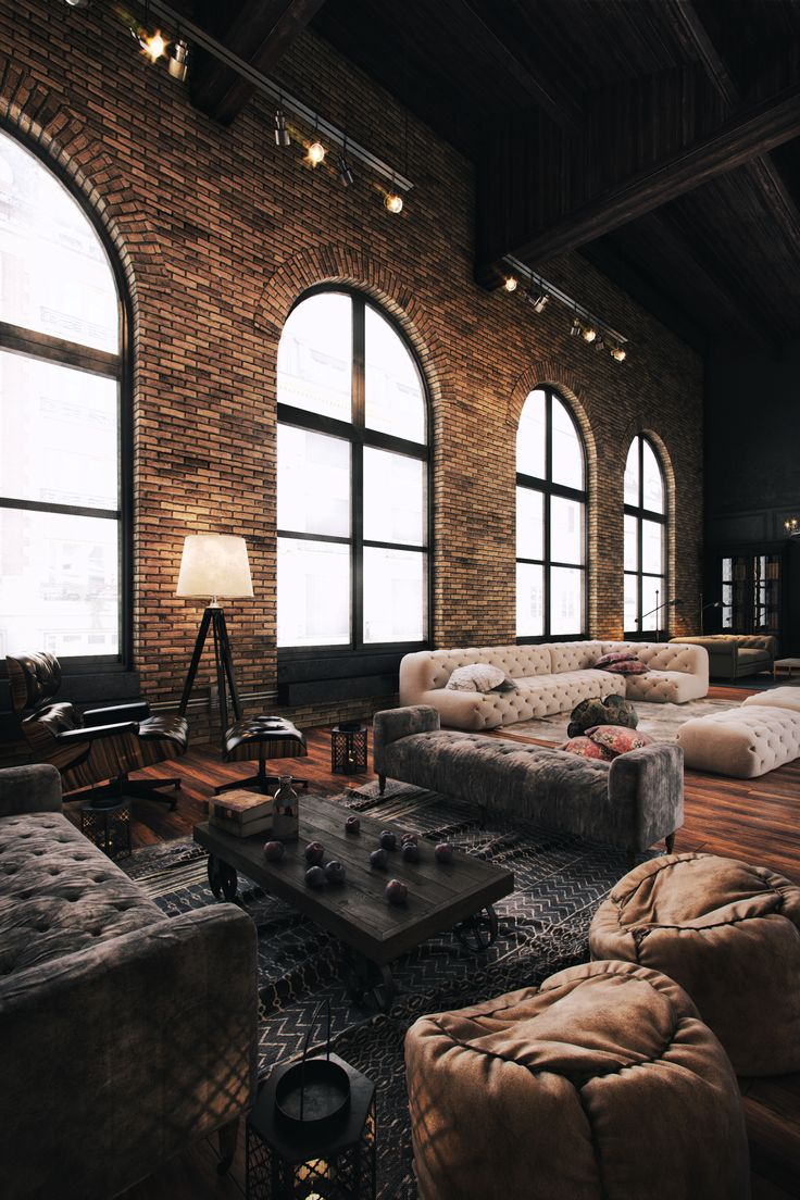 amazing loft space* those sofas + rugs* lighting + brick* cozy meets  industrial