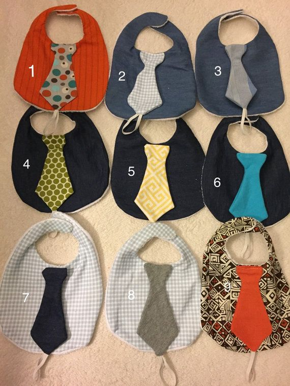 Baby boy necktie drool bib with binky holder, denim blue or patterned bib and tie with absorbent white terry cloth backing and Velcro closure. Perfect for a baby shower gift. Pacifier not included.  $12.00 each or two for $20.00.  Please indicate which number (1-10) bib(s) you would like in the comment section.  Look in my shop for other bib styles.  baby binky baby present bibs for babies binky pacifier cute baby gift cute baby stuff cute pacifiers gift for baby boy new baby gift idea new…