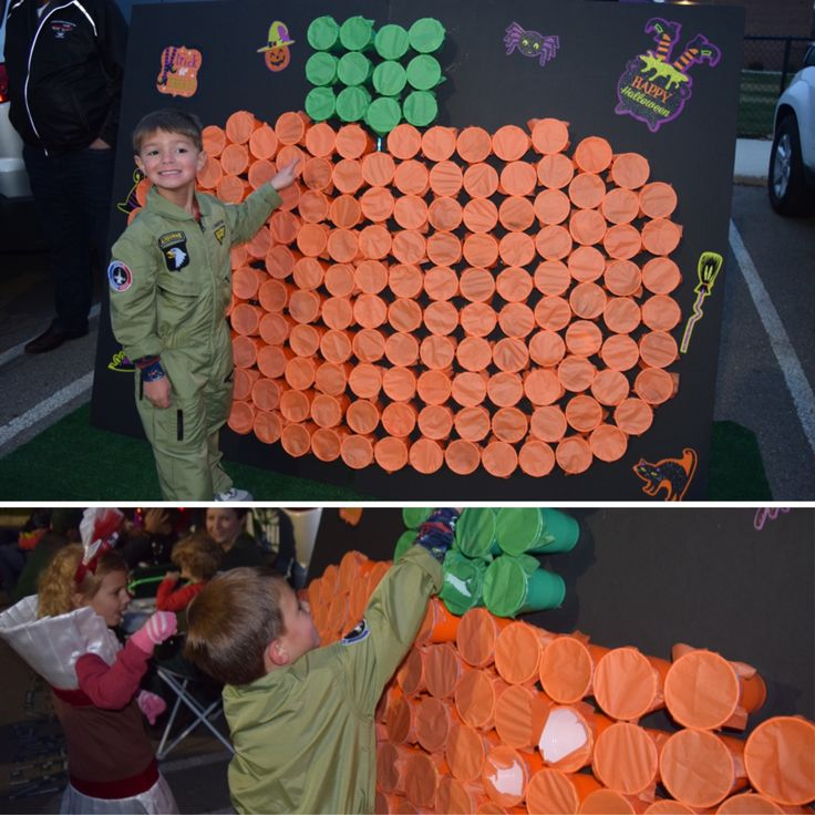 Poke-a-pumpkin Trunk-or-Treat game - orange and green solo cups filled with candy with a square piece of tissue paper secured with glue stick in Tim and rubber band - hot glued to board