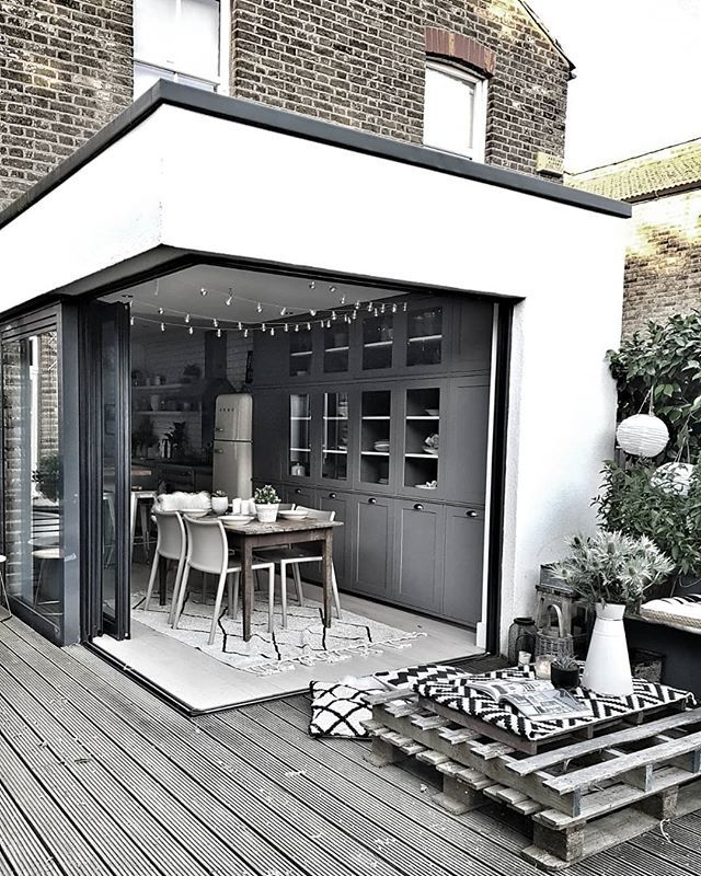 Contemporary Kitchen Extension With A Cantilevered Corner Belonging To Malmo And Moss The Con Indoor Outdoor Kitchen Outdoor Dining Spaces Kitchen Extension