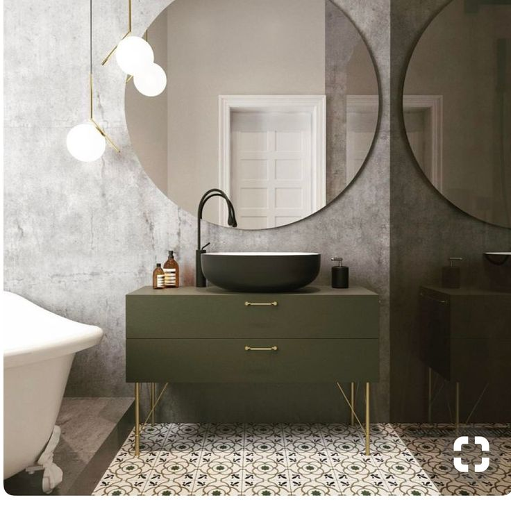 Big round mirror over vanity_bathroom