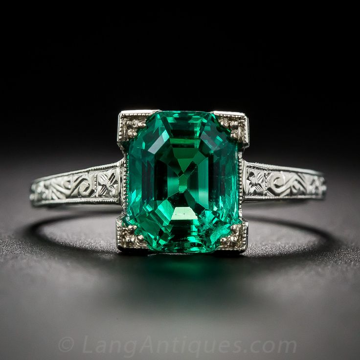 2.44 Carat Natural (No Enhancements) Gem Emerald and Platinum Ring... Classically proportioned, and weighing 2.44 carats, the breathtakingly beautiful, crystalline green emerald is simply presented within an original Art Deco solitaire mounting, hand fabricated in platinum and embellished with decorative hand engraving only