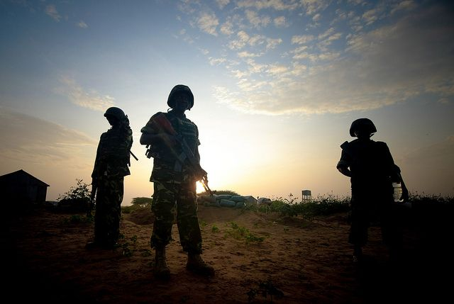 Soldiers from Burundi serving with the African Union Mission in Somalia (AMISOM) are seen along frontline positions just after sunrise in territory recently captured from insurgents in Deynile District along the furthest most northern fringes of the capital Mogadishu. AU-UN IST PHOTO / STUART PRICE.