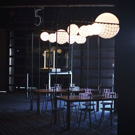 The Blocks by Studio Toogood  The wine bar has groups of spherical lamps representing grapes bunched overhead behind wire netting.