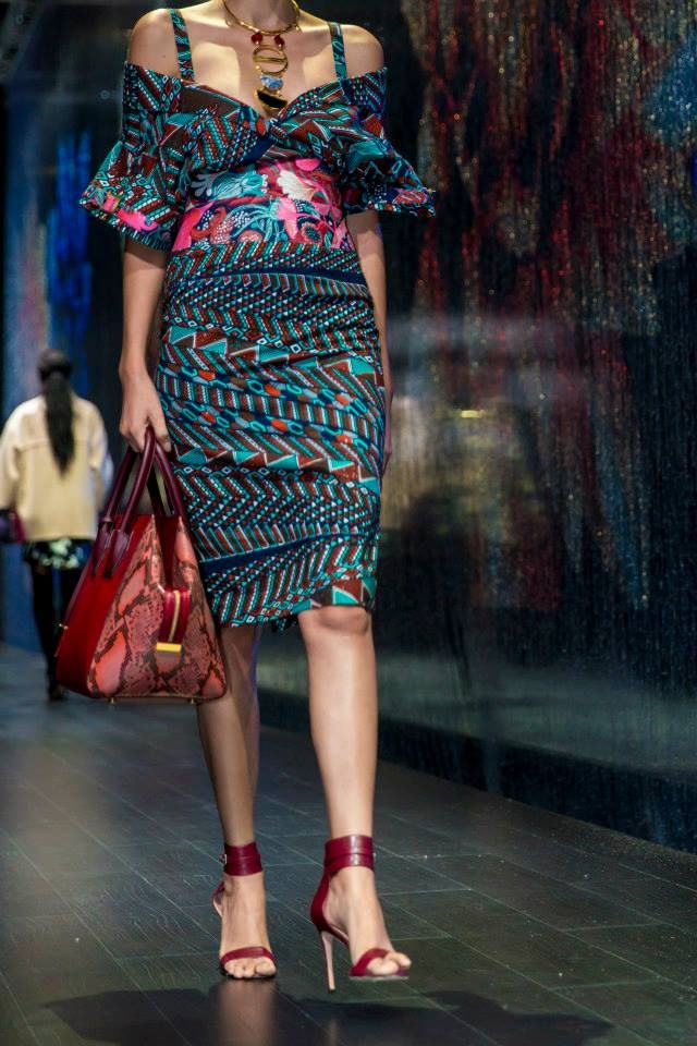 Stella Jean (dress), Stella McCartney (bag), Lizzie Fortunato (necklace) and Gianvito Rossi (shoes) at Harvey Nichols - Dubai