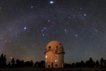 "Astrophotographer Jeff Dai sent in a photo of the night sky over southwestern China. He writes: ""The arc of winter Milky Way is photographed in this panoramic photo from Yunnan Astronomical Observatory in southwestern China. The dome, housing a 2.4 meter diameter telescope, is [illuminated] by the moonrise alpenglow."""