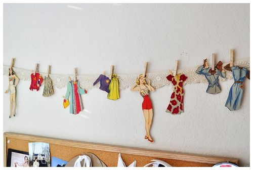 paper dolls on the wall.