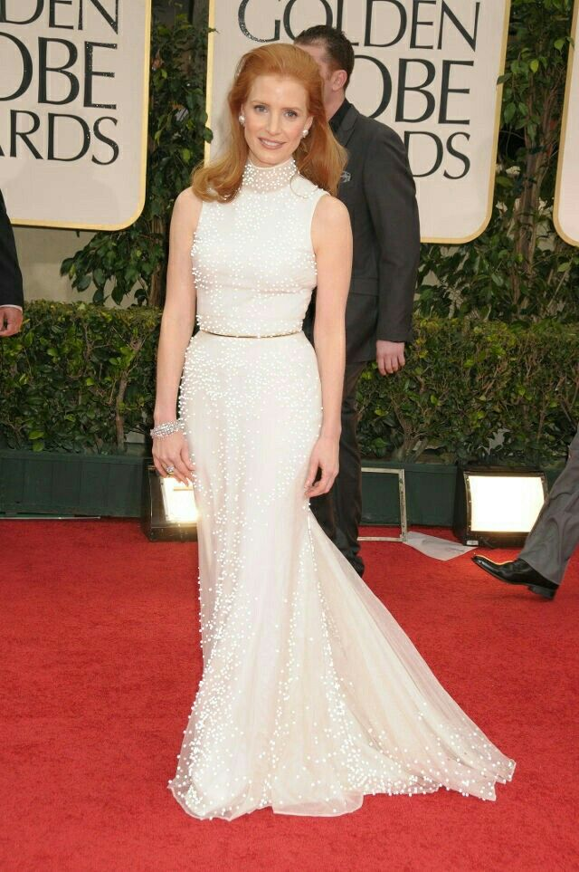 Ravishing Jessica Chastain arriving at the 2012 Golden Globe Awards in a high-neck Givenchy Haute Couture by Ricardo Tisci silk gown, whose pearly embellishments and thin gold metal belt matched perfectly with her ginger hair.