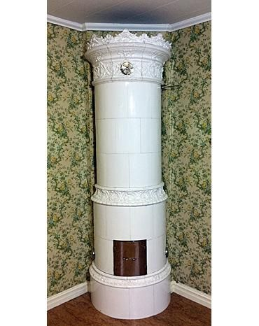 All white stove with many attractive relief decorations. Manufactured in 1895. Height 260 cm. Plinth diameter 82 cm.