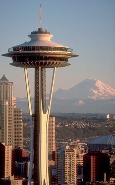 The Space Needle in Seattle, Washington with Mount Rainier in the background.