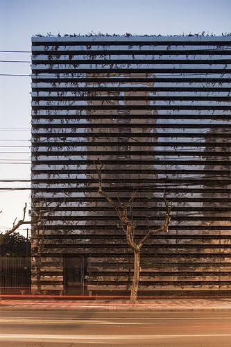 Mirror Banding on facade reflecting the building opposite, Shanghai | Kengo Kuma