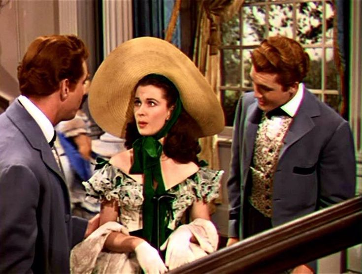 Scarlett O'Hara and the Tarleton twins at the Twelve Oaks barbecue in 'Gone With The Wind'.