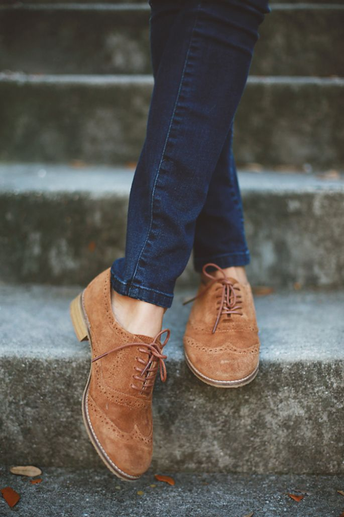 Jeans and brown oxfords. Choose the right top and bag to dress it up or down.
