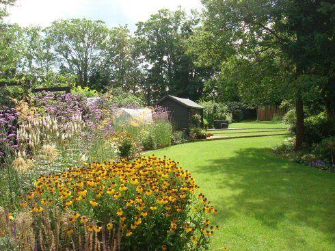 A long, narrow garden design in Woking, Surrey with a gorgeous prarie planting scheme. Designed by Linsey Evans Garden Design. www.linseysgardens.com