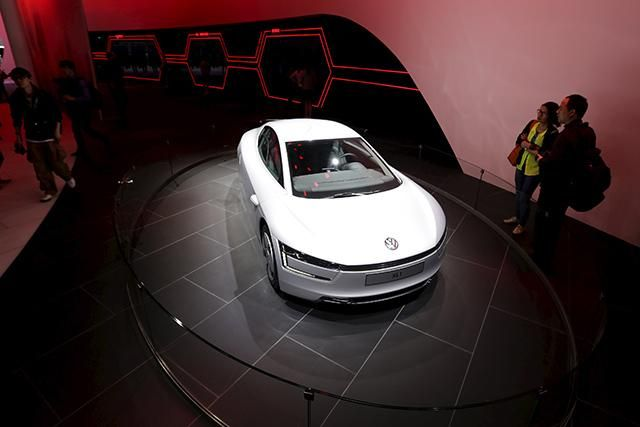 By 2040 electric vehicles will make up over a third of sales.  Volkswagen XL1 hybrid car displayed at Auto China 2014 in Beijing